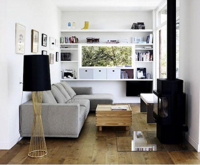 sala-pequena-bem-distribuida-com-mesa-de-centro-e-lareira